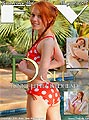 A freckled pigtailed redhead girl in red bikini with white dots printed on wants to fuck herself.