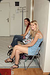 Two teen girls are waiting for waiting for interview.